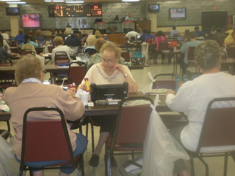 A bingo hall with some empty seats
