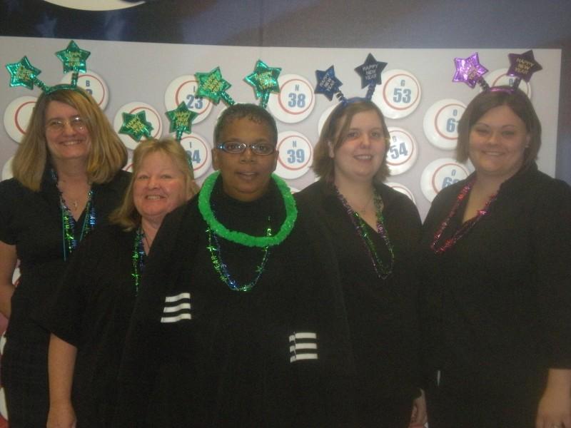 a group of women wear head stars
