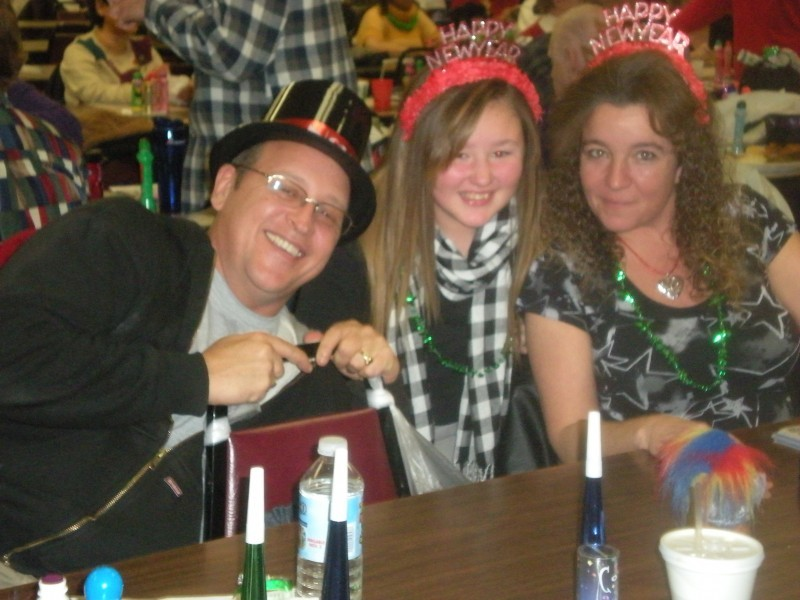 three people in happy new years headwear