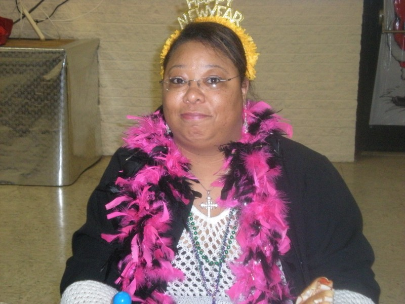 woman in pink boa and new years hat