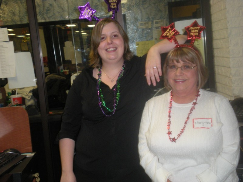 two women wear new years head stars