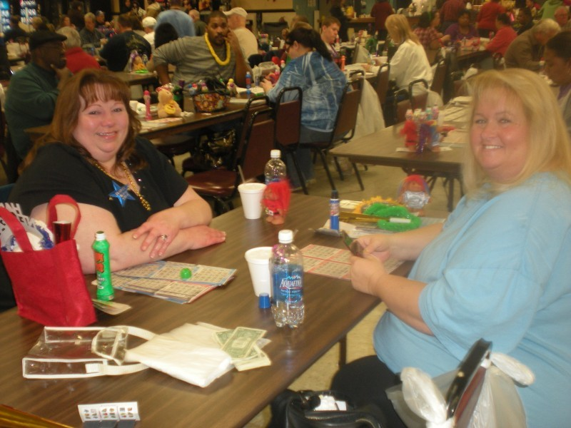 two women prepare to play a game of bingo