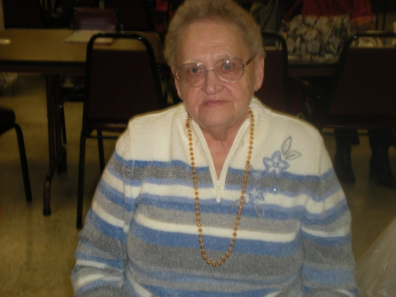 woman with glasses and gold beads
