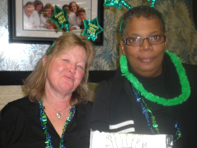 two women in happy new years green head stars