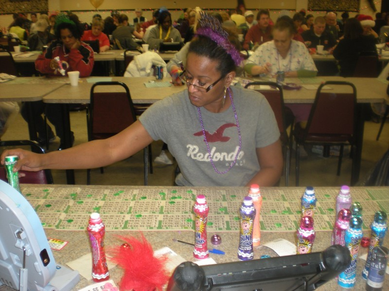 woman with a table full of bingo cards