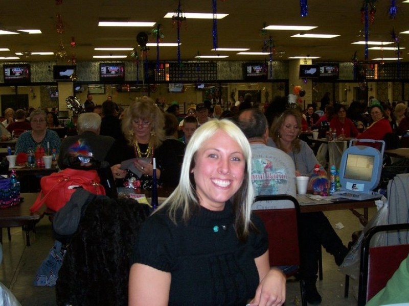 woman with blond hair smiles at bingo
