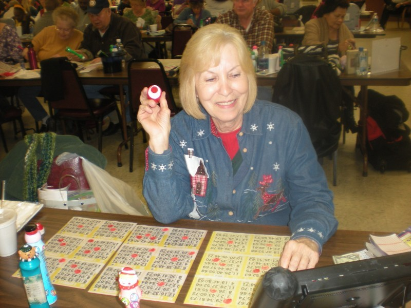 woman watches electronic bingo board