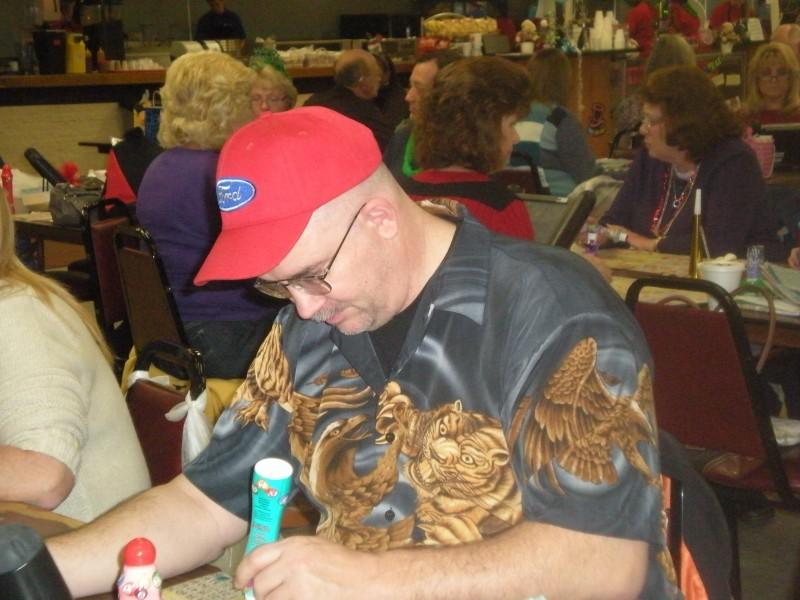 man wearing animal shirt plays bingo