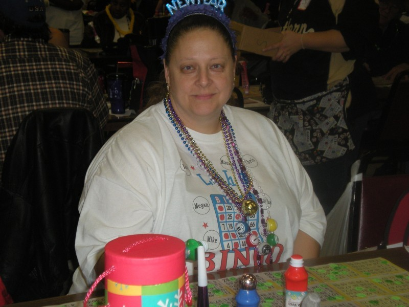 woman in bingo shirt celebrates new years with bingo
