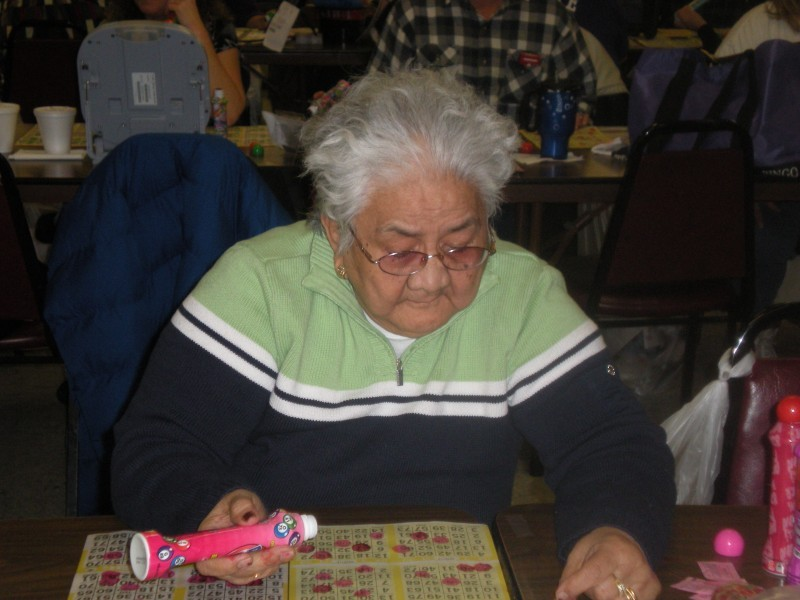 man watches his bingo cards