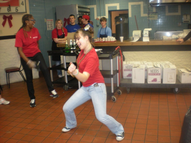 woman in red dancing in the kitchen
