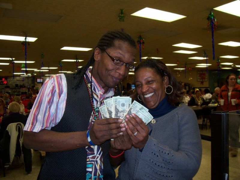 man and woman show off cash winnings