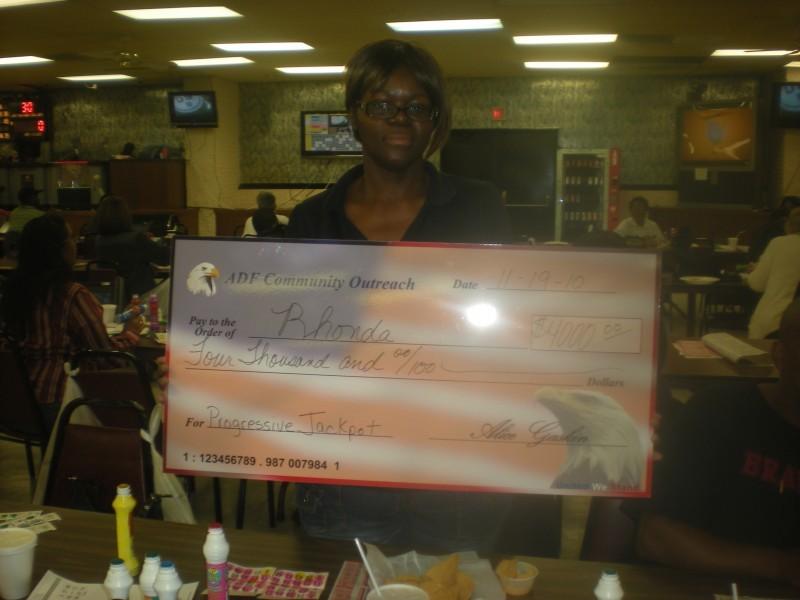 bingo winner holding her check